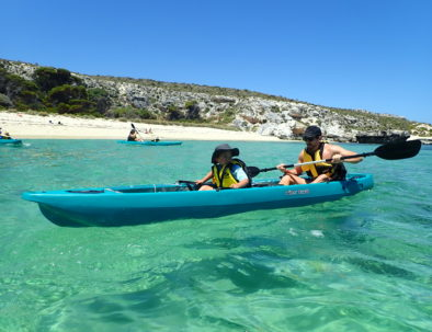 Father and son on glass bottom kayak in Rottnest